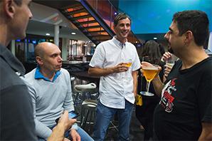 Guys having a beer