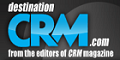 Destination CRM logo with white and blue letters on a black background